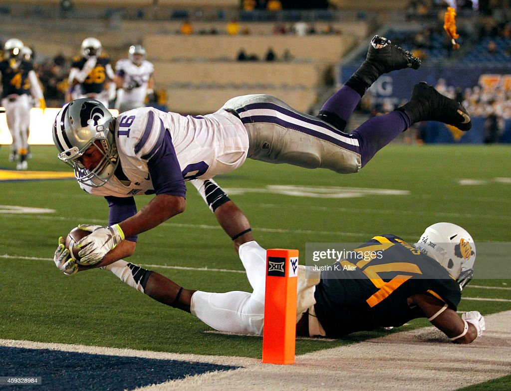 <a gi-track='captionPersonalityLinkClicked' href=/galleries/search?phrase=Tyler+Lockett&family=editorial&specificpeople=8364808 ng-click='$event.stopPropagation()'>Tyler Lockett</a> #16 of the Kansas State Wildcats dives for the pylon while a flag is being thrown for a offensive pass interference penalty during the game against Ishmael Banks #34 of the West Virginia Mountaineers on November 20, 2014 at Mountaineer Field in Morgantown, West Virginia. The Kansas State Wildcats defeated WVU