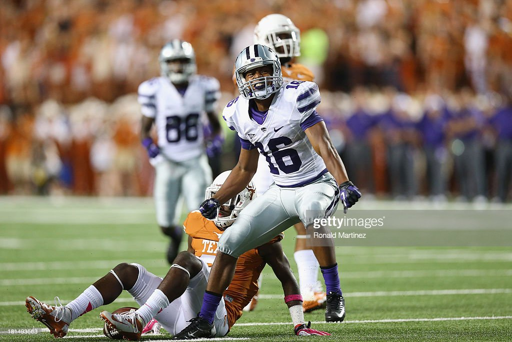 Tyler Lockett #16 of the Kansas State Wildcats reacts after making a pass reception against the Texas Longhorns at Darrell K Royal-Texas Memorial Stadium on September 21, 2013 in Austin, Texas.