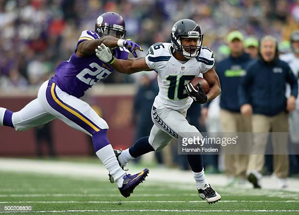 Tyler Lockett of the Seattle Seahawks carries the ball against Xavier Rhodes of the Minnesota Vikings during the first quarter of the game on...