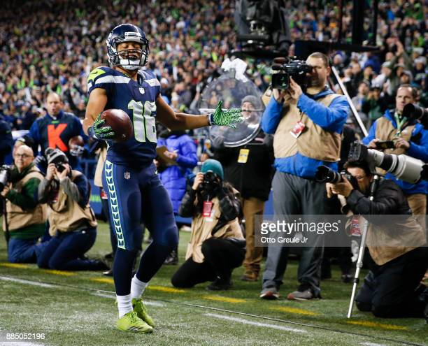Tyler Lockett of the Seattle Seahawks celebrates his 1 yard touchdown against the Philadelphia Eagles at CenturyLink Field on December 3 2017 in...