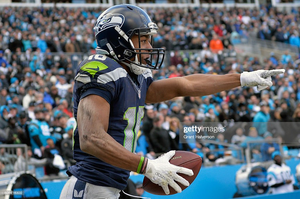 <a gi-track='captionPersonalityLinkClicked' href=/galleries/search?phrase=Tyler+Lockett&family=editorial&specificpeople=8364808 ng-click='$event.stopPropagation()'>Tyler Lockett</a> #16 of the Seattle Seahawks reacts after scoring a touchdown against the Carolina Panthers in the 3rd quarter during the NFC Divisional Playoff Game at Bank of America Stadium on January 17, 2016 in Charlotte, North Carolina.
