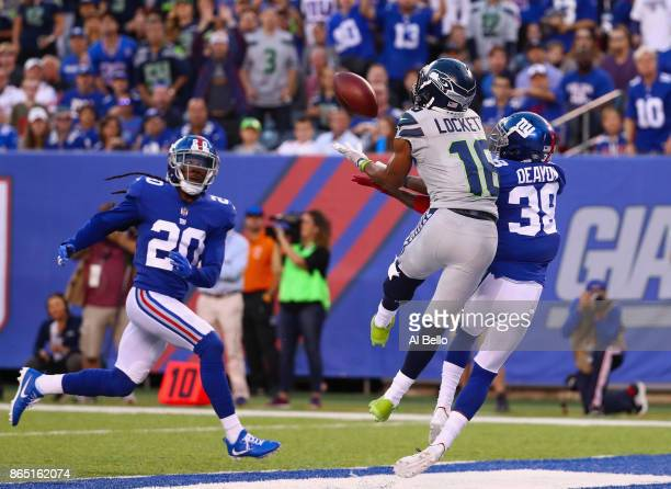 Tyler Lockett of the Seattle Seahawks scores a touchdown that is called back due to a penalty during the second quarter of the game against the New...