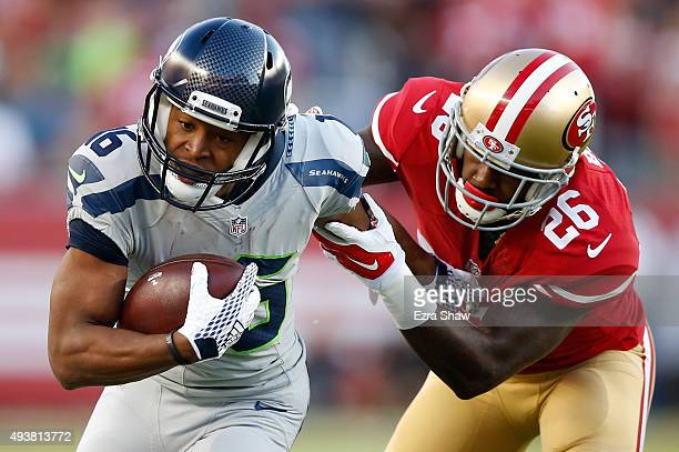 Tyler Lockett of the Seattle Seahawks tries to break a tackle from Tramaine Brock of the San Francisco 49ers during their NFL game at Levi's Stadium...