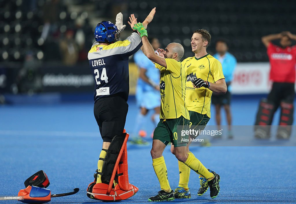 Tyler Lovell of Australia celebrates at the end of the match with team mates Matthew Swan and <a gi-track='captionPersonalityLinkClicked' href=/galleries/search?phrase=Simon+Orchard&family=editorial&specificpeople=4115447 ng-click='$event.stopPropagation()'>Simon Orchard</a> during the FIH Mens Hero Hockey Champions Trophy 1st-2nd place match between Australia and India at Queen Elizabeth Olympic Park on June 17, 2016 in London, England.