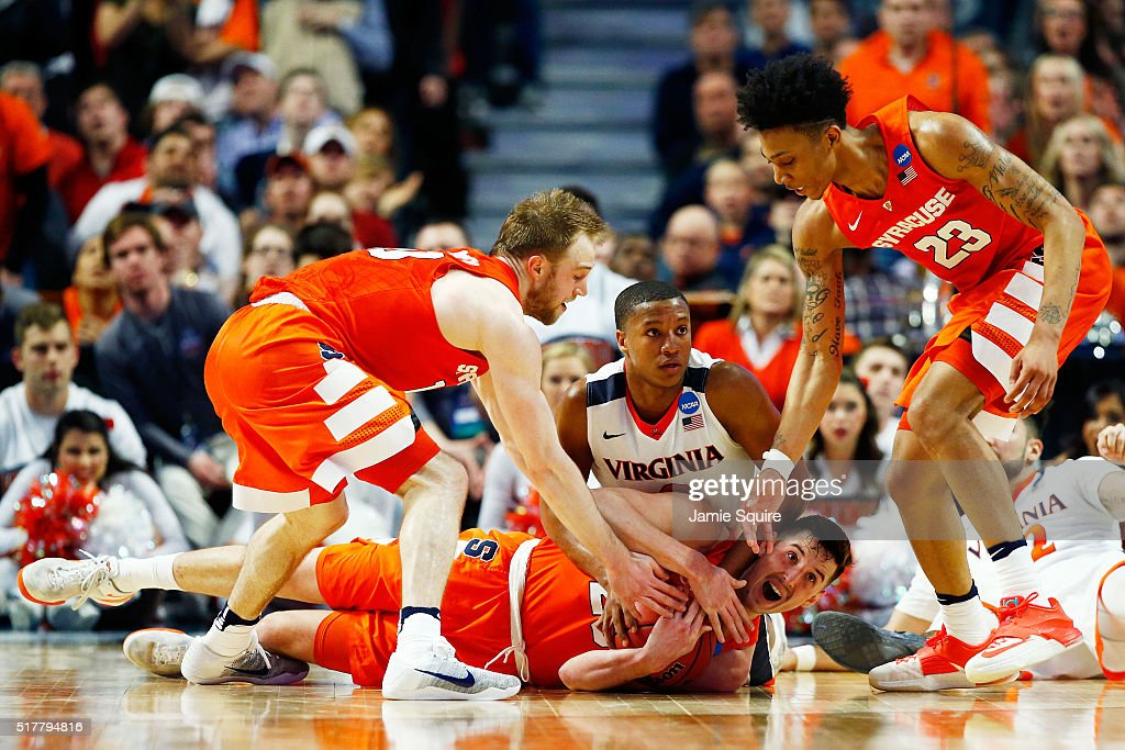 Tyler Lydon of the Syracuse Orange and Devon Hall of the Virginia Cavaliers vie for a looseball in the second half during the 2016 NCAA Men's...