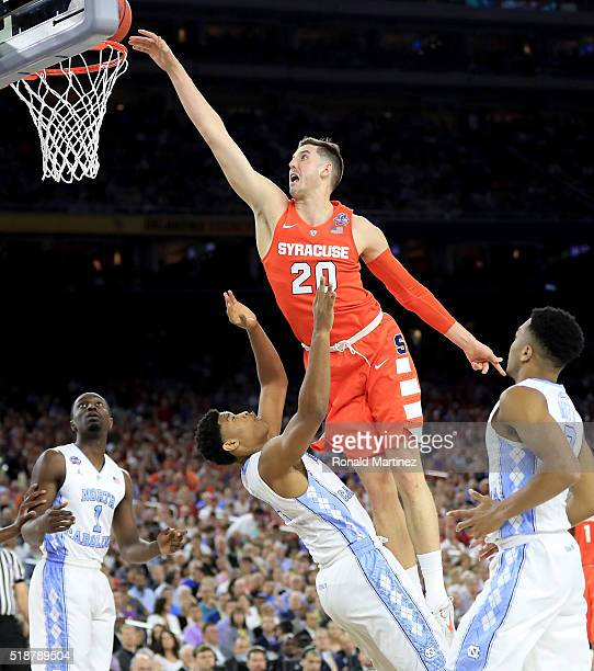 Tyler Lydon of the Syracuse Orange attempts to dunk the ball against Isaiah Hicks of the North Carolina Tar Heels in the first half during the NCAA...