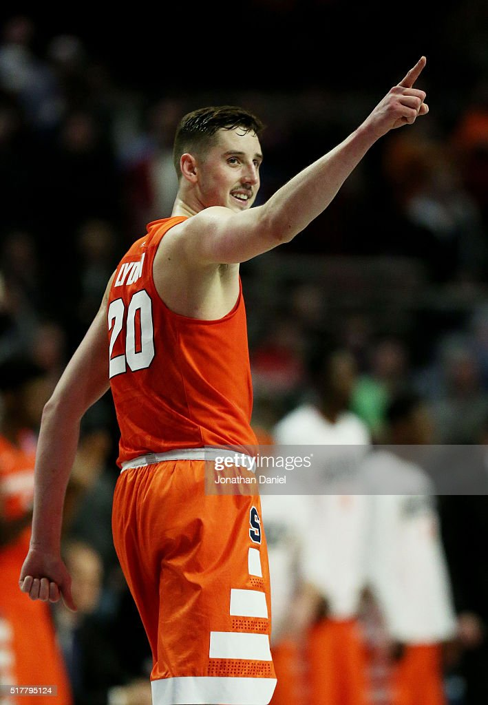 Tyler Lydon of the Syracuse Orange celebrates their 68 to 62 win over the Virginia Cavaliers with teammates during the 2016 NCAA Men's Basketball...