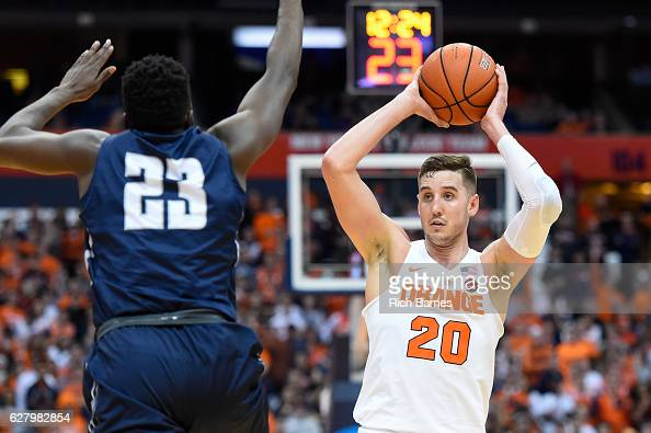 Tyler Lydon of the Syracuse Orange controls the ball as Nick Malonga of the North Florida Ospreys defends during the first half at the Carrier Dome...