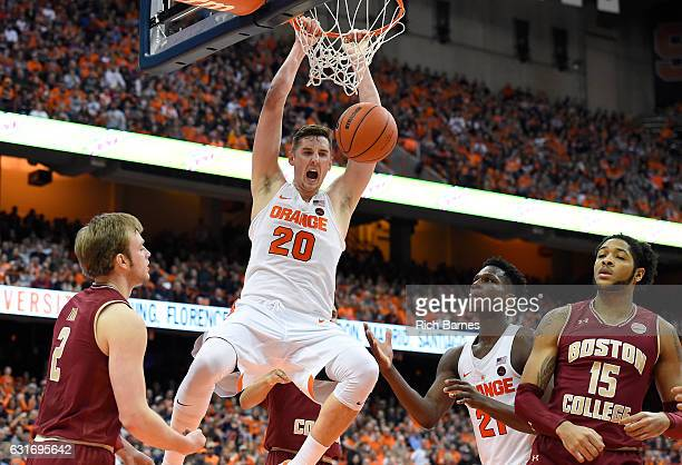 Tyler Lydon of the Syracuse Orange dunks the ball between Connar Tava of the Boston College Eagles and Tyler Roberson of the Syracuse Orange during...