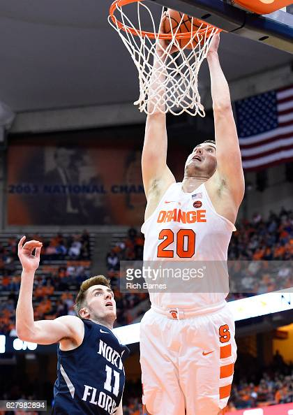 Tyler Lydon of the Syracuse Orange dunks the ball over Garrett Sams of the North Florida Ospreys during the first half at the Carrier Dome on...