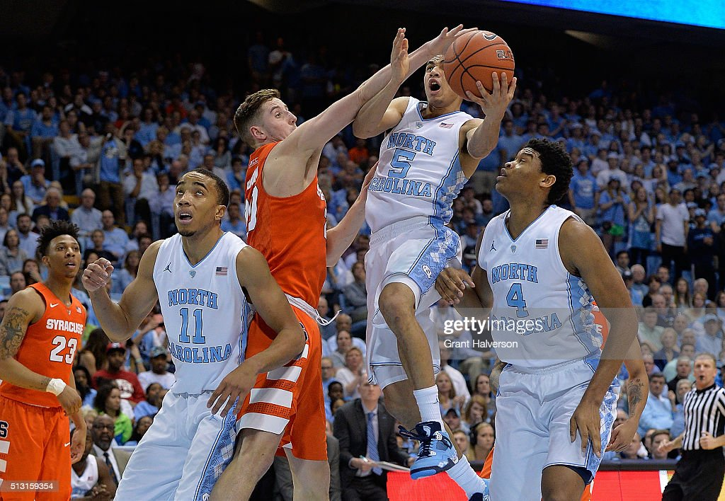 Tyler Lydon of the Syracuse Orange fouls Marcus Paige of the North Carolina Tar Heels during a game at the Dean Smith Center on February 29 2016 in...