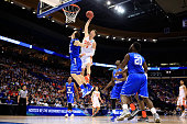 Tyler Lydon of the Syracuse Orange goes up for a dunk against Reggie Upshaw of the Middle Tennessee Blue Raiders in the first half during the second...