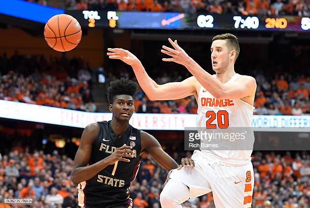 Tyler Lydon of the Syracuse Orange passes the ball around Jonathan Isaac of the Florida State Seminoles during the second half at the Carrier Dome on...