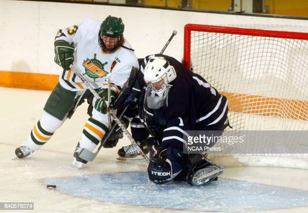 Tyler Lyon of Oswego State attacks the goal against Ross Cherry of Middlebury College during the Division III Men's Ice Hockey Championship held at...