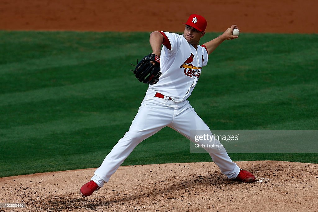 Tyler Lyons #70 of the St. Louis Cardinals pitches against the Miami Marlins at Roger Dean Stadium on February 28, 2013 in Jupiter, Florida.