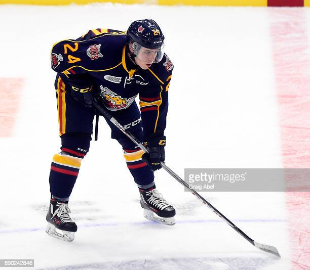 Tyler MacArthur of the Barrie Colts prepares for a faceoff against the Mississauga Steelheads during OHL game action on December 8 2017 at Hershey...