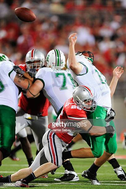 Tyler Moeller of the Ohio State Buckeyes sacks quarterback Brian Anderson of the Marshall Thundering Herd causing a fumble at Ohio Stadium on...