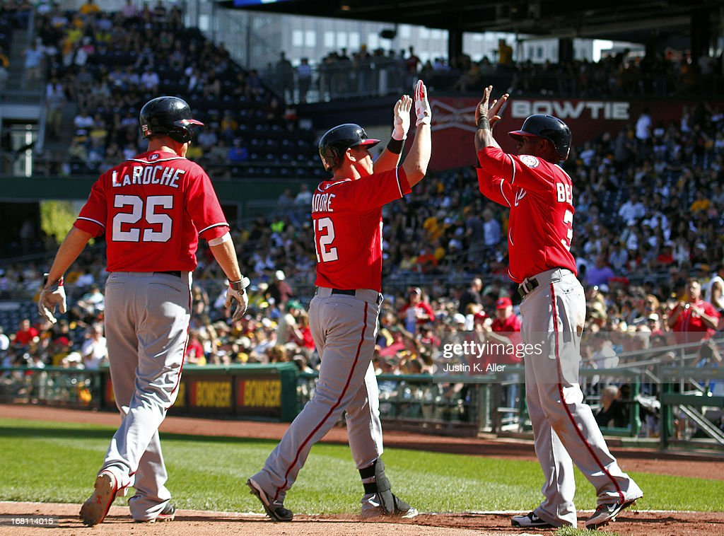 Tyler Moore #12 of the Washington Nationals celebrates after hitting a three run home run in the eighth inning against the Pittsburgh Pirates during the game on May 5, 2013 at PNC Park in Pittsburgh, Pennsylvania.