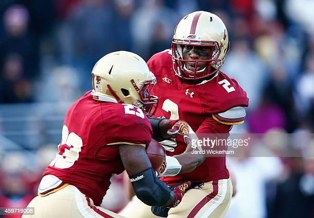 Tyler Murphy of the Boston College Eagles hands the ball off to teammate Myles Willis in the second half against the Syracuse Orangemen during the...