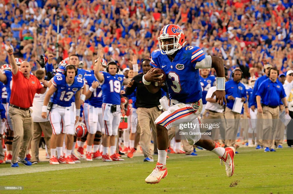 Tyler Murphy #3 of the Florida Gators runs for yardage during the game against the Georgia Bulldogs at EverBank Field on November 2, 2013 in Jacksonville, Florida.