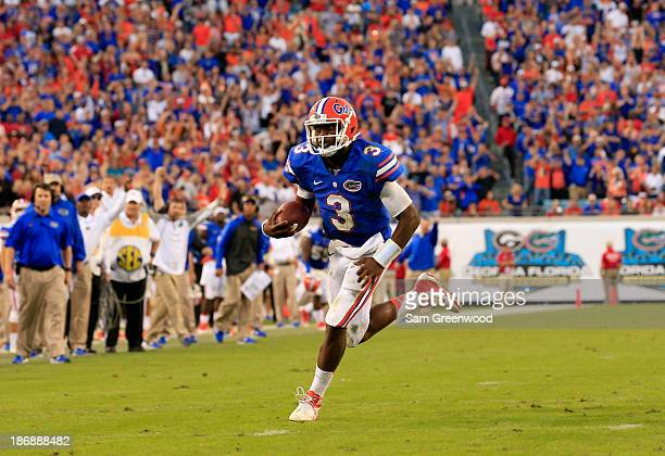 Tyler Murphy of the Florida Gators runs for yardage during the game against the Georgia Bulldogs at EverBank Field on November 2 2013 in Jacksonville...
