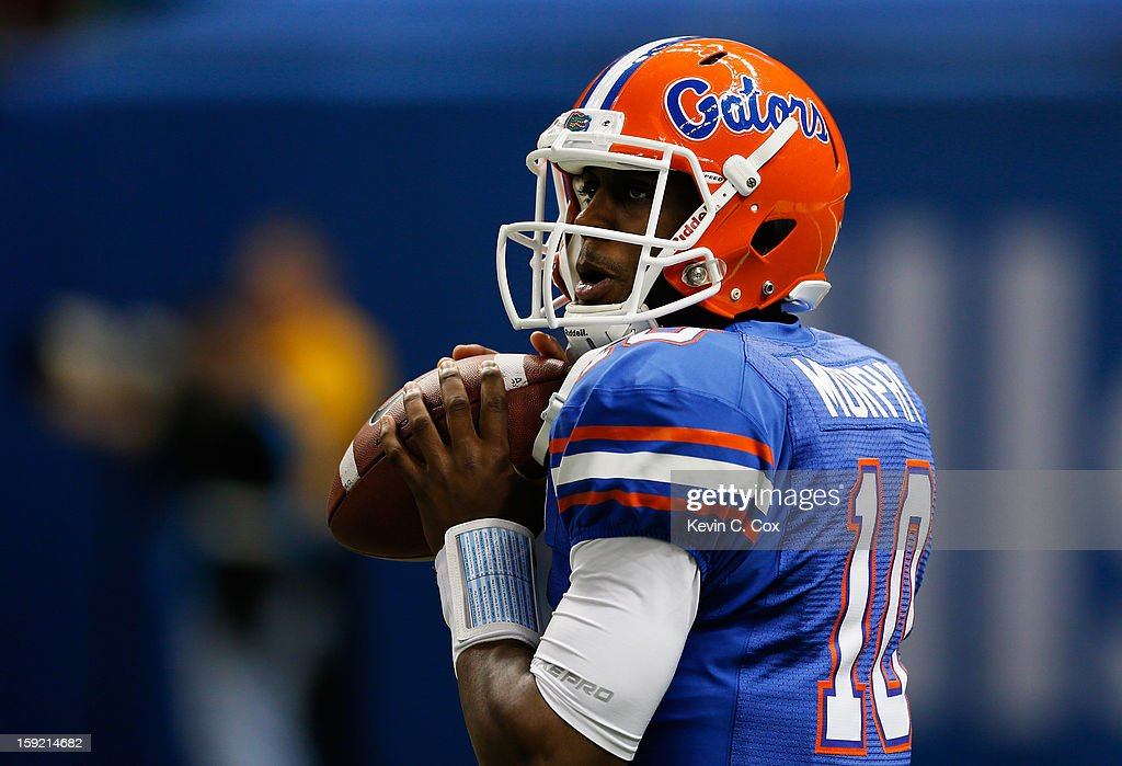 Tyler Murphy #10 of the Florida Gators warms up prior to their game against the Louisville Cardinals during the Allstate Sugar Bowl at Mercedes-Benz Superdome on January 2, 2013 in New Orleans, Louisiana.