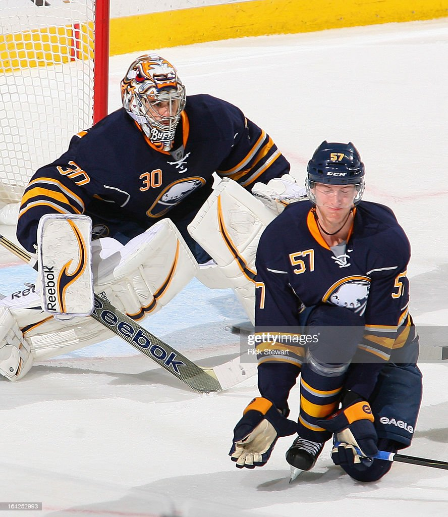 Tyler Myers #57 and Ryan Miller #30 of the Buffalo Sabres defend against the Toronto Maple Leafs at First Niagara Center on March 21, 2013 in Buffalo, United States.Buffalo won 5-4 in a shootout.