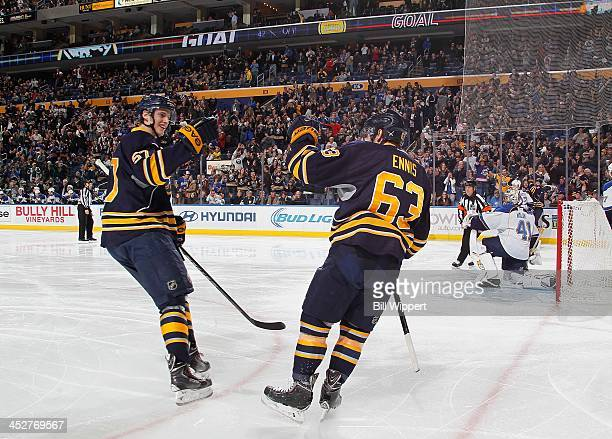 Tyler Myers and Tyler Ennis of the Buffalo Sabres celebrate a goal against the St Louis Blues on November 19 2013 at the First Niagara Center in...