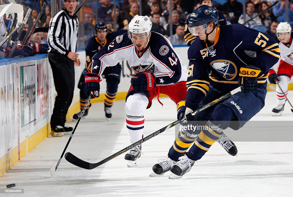 <a gi-track='captionPersonalityLinkClicked' href=/galleries/search?phrase=Tyler+Myers&family=editorial&specificpeople=4595080 ng-click='$event.stopPropagation()'>Tyler Myers</a> #57 of the Buffalo Sabres and <a gi-track='captionPersonalityLinkClicked' href=/galleries/search?phrase=Artem+Anisimov&family=editorial&specificpeople=543215 ng-click='$event.stopPropagation()'>Artem Anisimov</a> #42 of the Columbus Blue Jackets battle for the puck along the boards at First Niagara Center on October 10, 2013 in Buffalo, New York. Columbus defeated Buffalo 4-1.