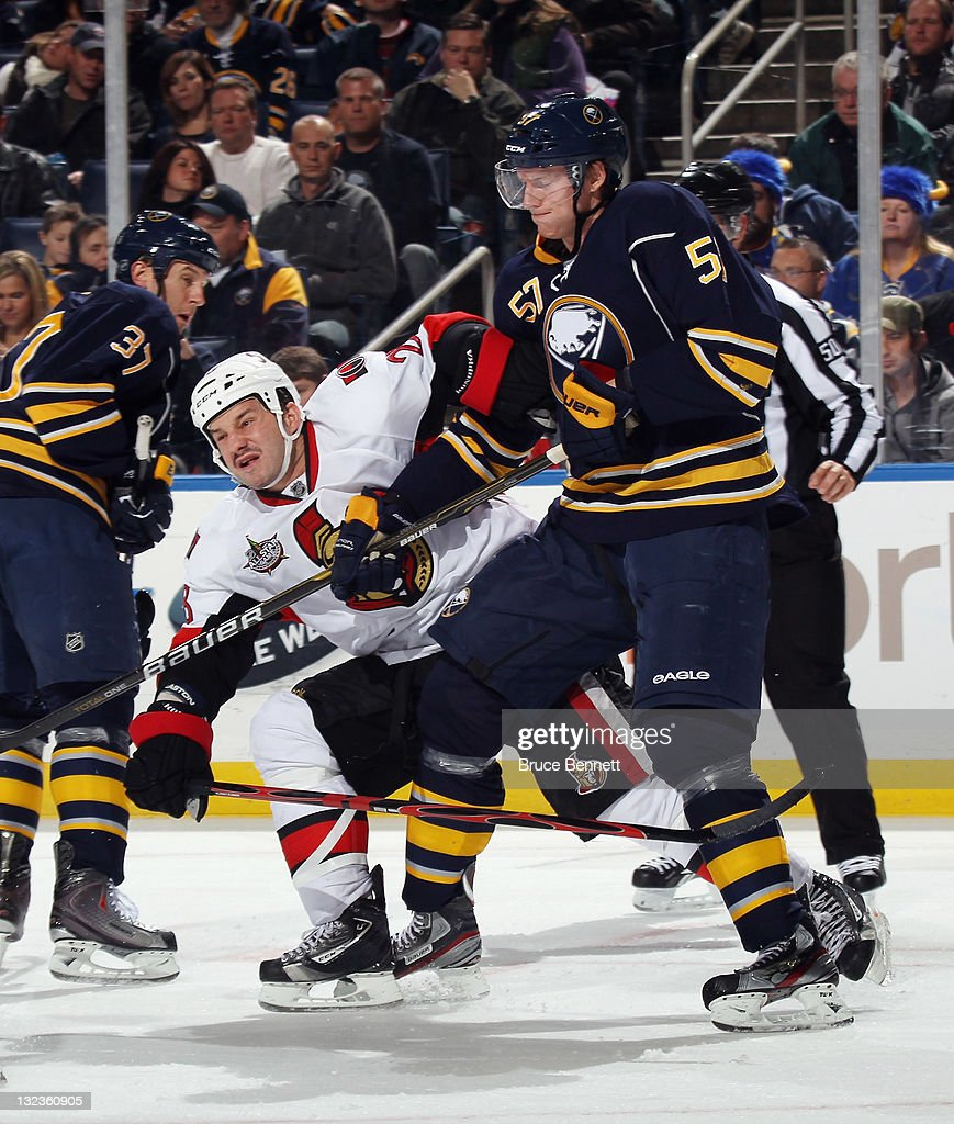 <a gi-track='captionPersonalityLinkClicked' href=/galleries/search?phrase=Tyler+Myers&family=editorial&specificpeople=4595080 ng-click='$event.stopPropagation()'>Tyler Myers</a> #57 of the Buffalo Sabres and <a gi-track='captionPersonalityLinkClicked' href=/galleries/search?phrase=Zenon+Konopka&family=editorial&specificpeople=2105876 ng-click='$event.stopPropagation()'>Zenon Konopka</a> #28 of the Ottawa Senators battle at the First Niagara Center on November 11, 2011 in Buffalo, New York. The Sabres defeated the Senators 5-1.