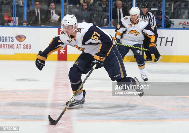 Tyler Myers of the Buffalo Sabres carries the puck against the Atlanta Thrashers at Philips Arena on March 16 2010 in Atlanta Georgia
