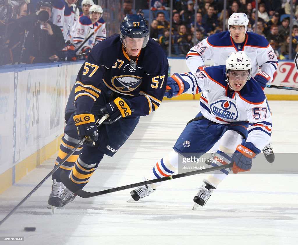 <a gi-track='captionPersonalityLinkClicked' href=/galleries/search?phrase=Tyler+Myers&family=editorial&specificpeople=4595080 ng-click='$event.stopPropagation()'>Tyler Myers</a> #57 of the Buffalo Sabres carries the puck up ice against David Peron #57 of the Edmonton Oilers at First Niagara Center on February 3, 2014 in Buffalo, New York. The Edmonton Oilers defeated the Buffalo Sabres 3-2.