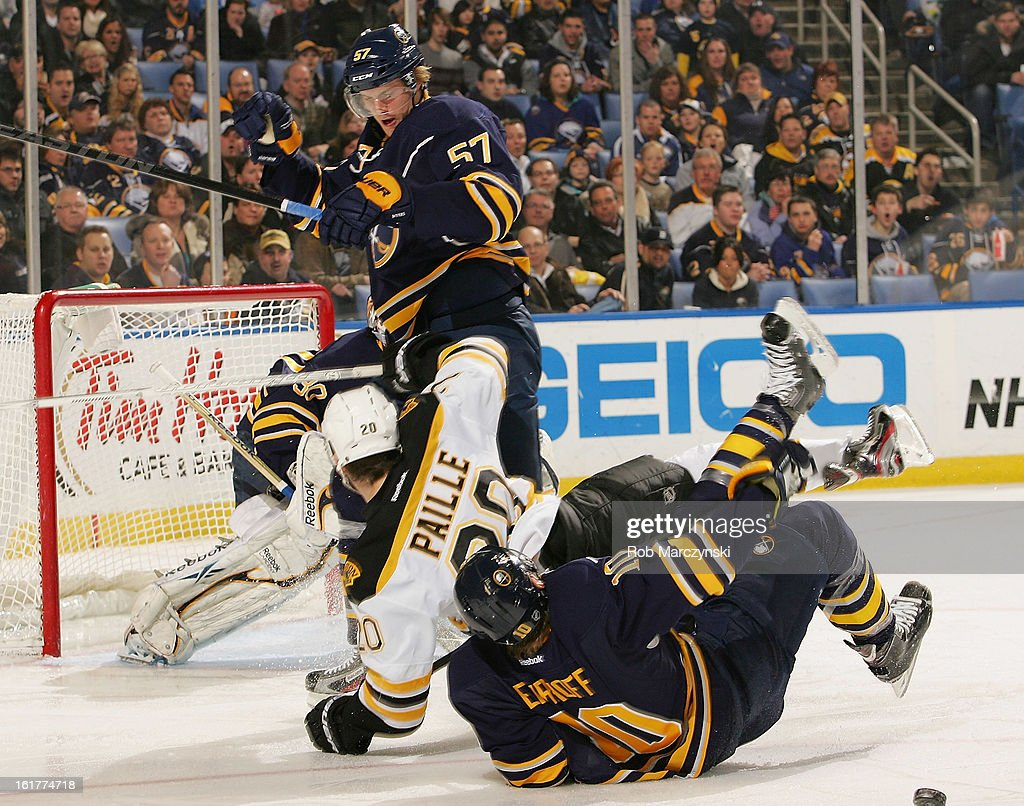 <a gi-track='captionPersonalityLinkClicked' href=/galleries/search?phrase=Tyler+Myers&family=editorial&specificpeople=4595080 ng-click='$event.stopPropagation()'>Tyler Myers</a> #57 of the Buffalo Sabres checks <a gi-track='captionPersonalityLinkClicked' href=/galleries/search?phrase=Daniel+Paille&family=editorial&specificpeople=706561 ng-click='$event.stopPropagation()'>Daniel Paille</a> #20 of the Boston Bruins into <a gi-track='captionPersonalityLinkClicked' href=/galleries/search?phrase=Christian+Ehrhoff&family=editorial&specificpeople=214788 ng-click='$event.stopPropagation()'>Christian Ehrhoff</a> #10 of the Sabres on February 15, 2013 at the First Niagara Center in Buffalo, New York.