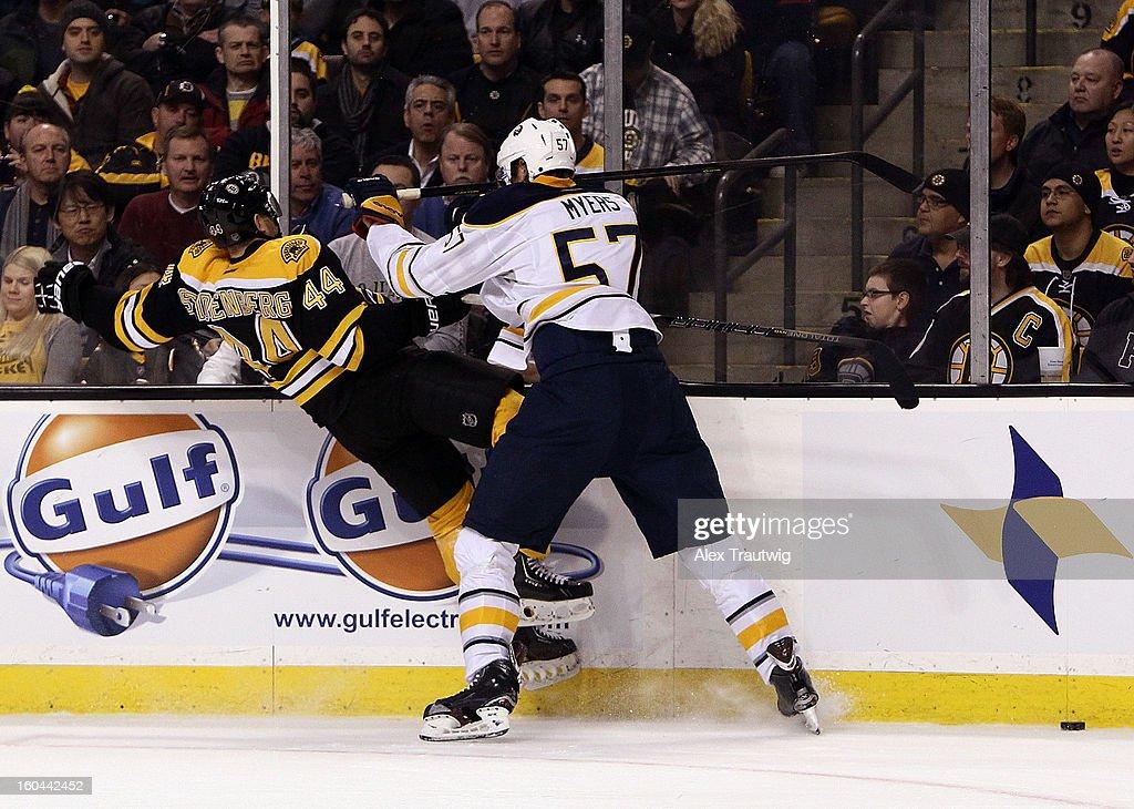 Tyler Myers #57 of the Buffalo Sabres checks Dennis Seidenberg #44 of the Boston Bruins during a game at the TD Garden on January 31, 2013 in Boston, Massachusetts.