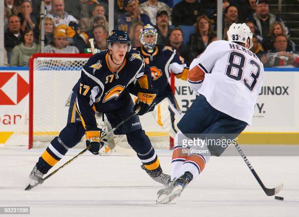 Tyler Myers of the Buffalo Sabres defends against Ales Hemsky of the Edmonton Oilers on November 11 2009 at HSBC Arena in Buffalo New York The Sabres...