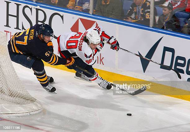 Tyler Myers of the Buffalo Sabres defends against Marcus Johansson of the Washington Capitals at HSBC Arena on February 20 2011 in Buffalo New York