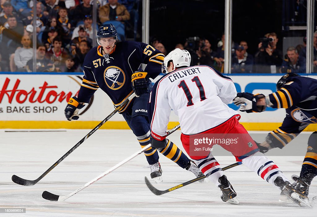<a gi-track='captionPersonalityLinkClicked' href=/galleries/search?phrase=Tyler+Myers&family=editorial&specificpeople=4595080 ng-click='$event.stopPropagation()'>Tyler Myers</a> #57 of the Buffalo Sabres defends as Matt Calvert #11 of the Columbus Blue Jackets carries the puck up ice at First Niagara Center on October 10, 2013 in Buffalo, New York. Columbus defeated Buffalo 4-1.