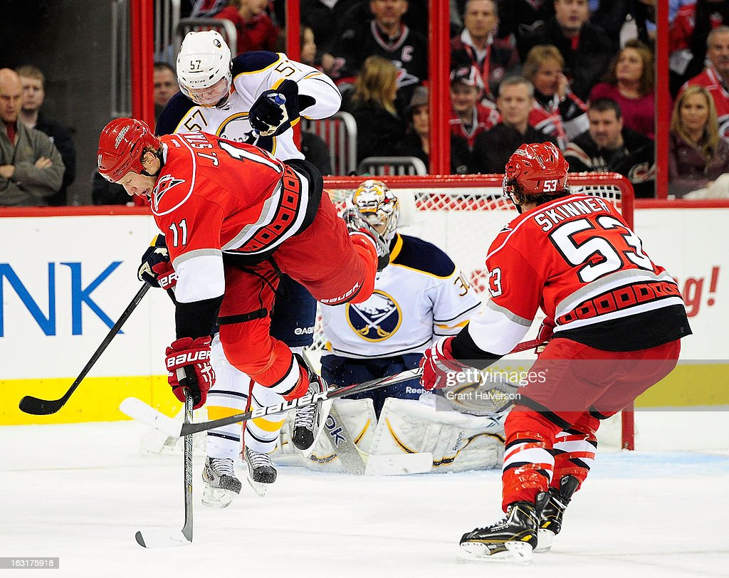 <a gi-track='captionPersonalityLinkClicked' href=/galleries/search?phrase=Tyler+Myers&family=editorial&specificpeople=4595080 ng-click='$event.stopPropagation()'>Tyler Myers</a> #57 of the Buffalo Sabres knocks <a gi-track='captionPersonalityLinkClicked' href=/galleries/search?phrase=Jordan+Staal&family=editorial&specificpeople=533044 ng-click='$event.stopPropagation()'>Jordan Staal</a> #11 of the Carolina Hurricanes off of his skates during play at PNC Arena on March 5, 2013 in Raleigh, North Carolina.