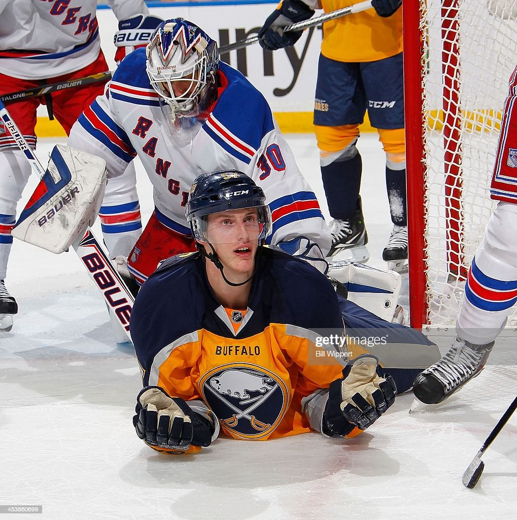 <a gi-track='captionPersonalityLinkClicked' href=/galleries/search?phrase=Tyler+Myers&family=editorial&specificpeople=4595080 ng-click='$event.stopPropagation()'>Tyler Myers</a> #57 of the Buffalo Sabres questions the referee after being upended during a third period scoring chance against <a gi-track='captionPersonalityLinkClicked' href=/galleries/search?phrase=Henrik+Lundqvist&family=editorial&specificpeople=217958 ng-click='$event.stopPropagation()'>Henrik Lundqvist</a> #30 of the New York Rangers on December 5, 2013 at the First Niagara Center in Buffalo, New York. New York won, 3-1.