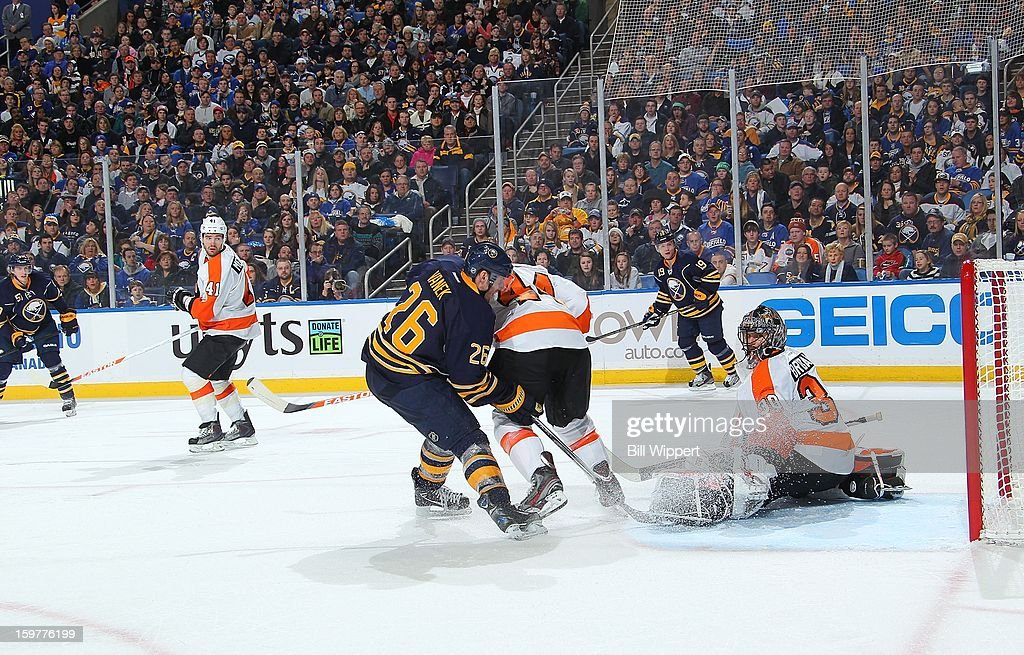 Tyler Myers #57 (L) of the Buffalo Sabres scores a third period goal against Ilya Bryzgalov #30 of the Philadelphia Flyers with help from teammate Thomas Vanek #26 on January 20, 2013 at the First Niagara Center in Buffalo, New York. Vanek had five points and Buffalo defeated Philadelphia, 5-2.