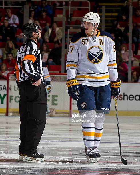 Tyler Myers of the Buffalo Sabres skates to the penalty box and has a few words for referee Chris Lee during a NHL game against the Detroit Red Wings...