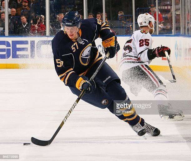 Tyler Myers of the Buffalo Sabres skates with the puck against the Chicago Blackhawks on December 11 2009 at HSBC Arena in Buffalo New York