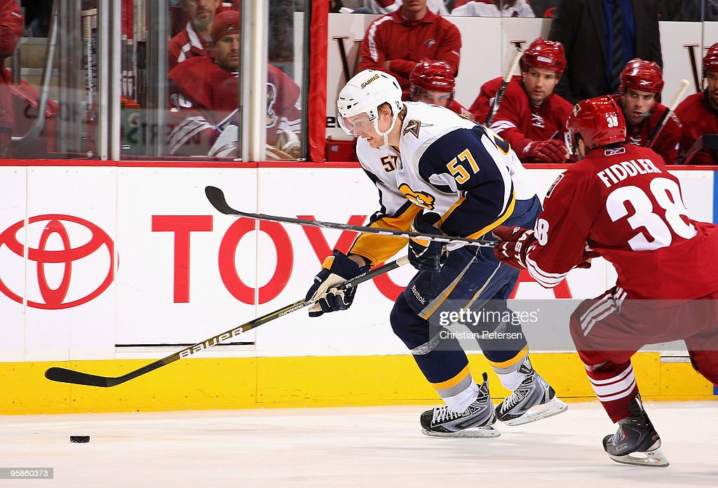 <a gi-track='captionPersonalityLinkClicked' href=/galleries/search?phrase=Tyler+Myers&family=editorial&specificpeople=4595080 ng-click='$event.stopPropagation()'>Tyler Myers</a> #57 of the Buffalo Sabres skates with the puck during the NHL game against the Phoenix Coyotes at Jobing.com Arena on January 18, 2010 in Glendale, Arizona. The Sabres defeated the Coyotes 7-2.