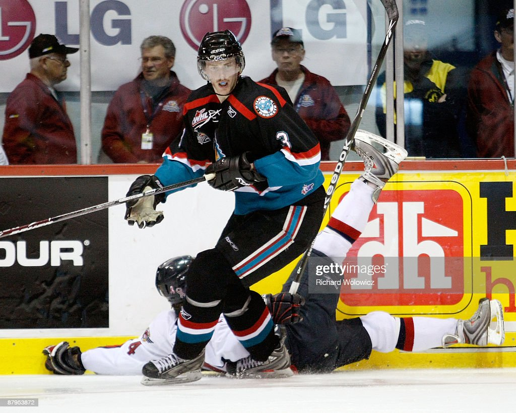 Tyler Myers of the Kelowna Rockets body checks Taylor Hall of the Windsor Spitfires during the 2009 Mastercard Memorial Cup Final at the Rimouski...