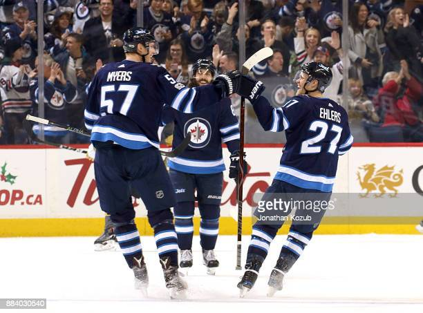 Tyler Myers of the Winnipeg Jets celebrates his first period goal against the Vegas Golden Knights with teammate Nikolaj Ehlers at the Bell MTS Place...