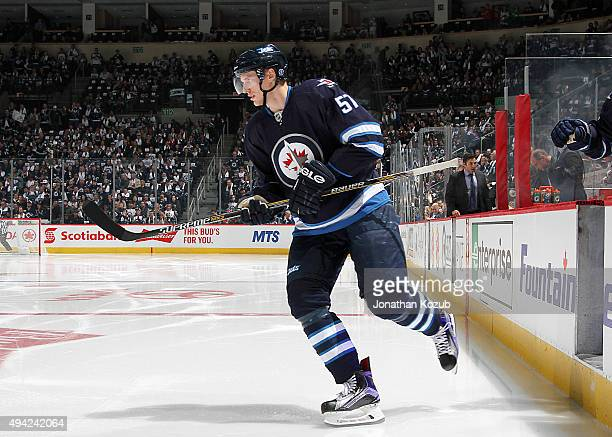 Tyler Myers of the Winnipeg Jets hits the ice prior to puck drop against the Minnesota Wild at the MTS Centre on October 25 2015 in Winnipeg Manitoba...