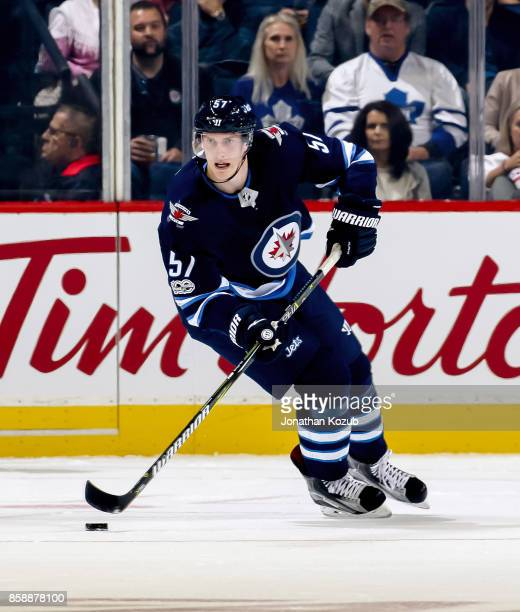 Tyler Myers of the Winnipeg Jets plays the puck down the ice during first period action against the Toronto Maple Leafs at the Bell MTS Place on...