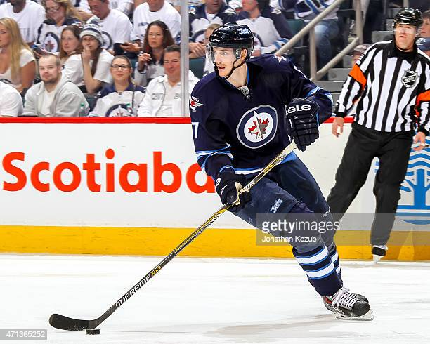 Tyler Myers of the Winnipeg Jets plays the puck during second period action against the Anaheim Ducks in Game Four of the Western Conference...
