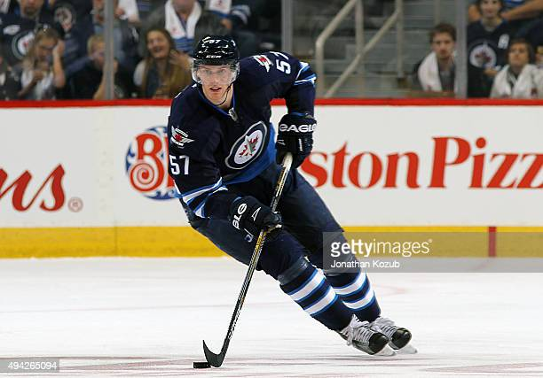 Tyler Myers of the Winnipeg Jets plays the puck up the ice during second period action against the Minnesota Wild at the MTS Centre on October 25...