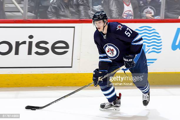Tyler Myers of the Winnipeg Jets plays the puck up the ice during second period action against the Chicago Blackhawks at the MTS Centre on March 18...